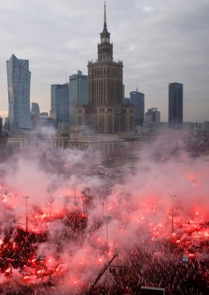 POLISH INDEPENDENCE: People carry flags and flares during a march marking the 101st anniversary of Polish independence in Warsaw, Poland. Photograph: Kacper Pempel/Reuters