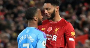 Raheem Sterling  and  Joe Gomez clash during the Premier League match at Anfield. Photograph: Peter Byrne/PA Wire