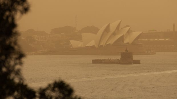 A smoke haze from the bushfires shrouds the Sydney Opera House. Photograph: Paul Braven/ EPA
