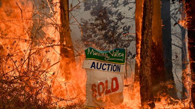 A bushfire burns outside a property near Taree, north of Sydney. Photograph: Peter Parks/AFP/Getty