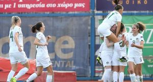 Ireland striker Amber Barrett is mobbed by her team-mates after she scored  in the Uefa Women's European Championship qualifier against Greece in  Panionios, Athens. Photograph: Greg Hellas/Inpho