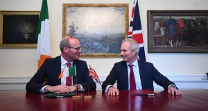 The Tory party will shed grandees like Theresa May's de facto deputy David Lidington, pictured with Tánaiste Simon Coveney last May. Photograph: Victoria Jones/PA Wire