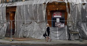 "A pedestrian passes a dilapidated building in Hartlepool, northeast England. It is one of the 10 poorest places in England, with more than one in five people  living in ""income-deprived households"". Photograph:  Getty Images"
