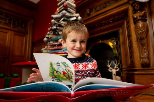 BOOKWORM: Jack Siron (3),  from Wicklow, in front of a bookish Christmas tree at the National Library of Ireland, Kildare Street, for the launch of the Dublin Book Festival, running from November 14th to 17th. Photograph: Tom Honan