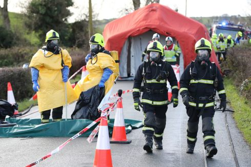 EVER-READY: Fire crews from Northern Ireland and the Republic take part in a multi-agency emergency response exercise after a simulated crash involving a fuel truck and bus in Castleblayney, Co Monaghan. Photograph: Niall Carson/PA Wire
