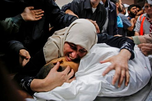 A MOTHER MOURNS: The mother of Palestinian Zaki Ghanama (25), mourns over his body at a hospital morgue in Beit Lahia in the northern Gaza Strip, following an Israeli air strike. Israel said it carried out a strike against militants preparing to launch rockets. The incident followed an Israeli strike that killed an Islamic Jihad commander. Photograph: Anas BabaAFP/Getty