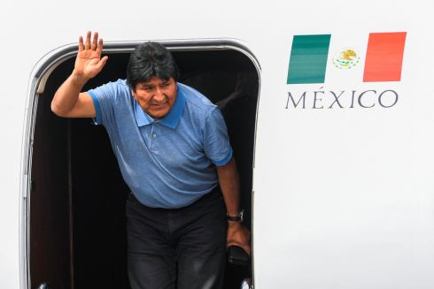 POLITICAL ASYLUM: Evo Morales, who has stepped down as Bolivian president, waves upon landing in Mexico City in a government aircraft. He was granted political asylum by Mexico after his resignation. Photograph: Pedro Pardo/AFP/Getty