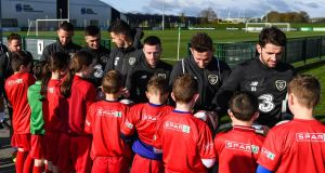 A group of schoolchildren meet the Irish senior football team at their Abbotstown base ahead of Thursday night's friendly match against New Zealand and next week's Euro 2020 qualifier versus Denmark. Photograph: Sportsfile