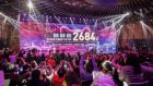 Attendees record the final sales tally at an event at Alibaba's headquarters marking Singles Day. Photograph: Qilai Shen/Bloomberg
