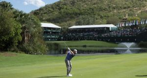 Louis Oosthuizen of South Africa plays his second shot to the 18th during the first round of the Nedbank Golf Challenge. Photograph: Jan Kruger/Getty Images
