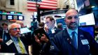 Traders at the New York Stock Exchange. Photograph: Johannes Eisele/AFP via Getty