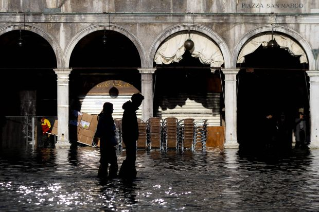 People walk across the flooded St Mark's Square in Venice on Thursday. Photograph: Filippo Monteforte/AFP via Getty