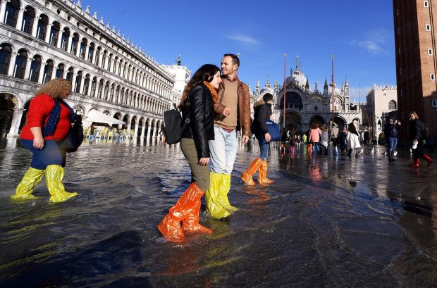 As residents assessed the implications of the floods, tourists were enjoying the novelty. Photograph: Filippo Monteforte/AFP via Getty