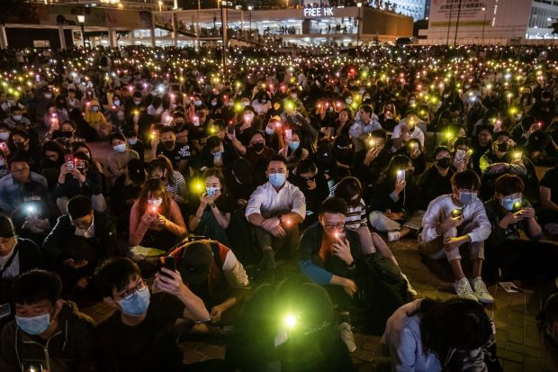 Demonstrators shine lights from smartphones during a rally at Edinburgh Place in the Central district of Hong Kong on Thursday. Photograph: Justin Chin/Bloomberg