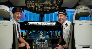 Qantas nonstop flight: Capt Helen Trenerry and First Officer Ryan Gill demonstrate the monitors they wore during the London-Sydney test trip