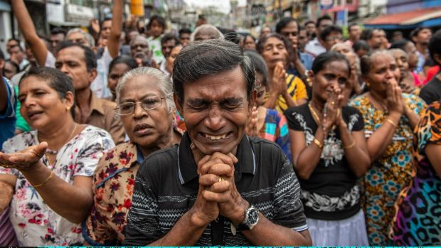 People pray in the street near St Anthony's Shrine one week after the attacks that killed more than 250 people on April 28th last in Colombo. Photograph Carl Court/Getty Images