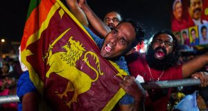 Supporters of Sri Lanka's Podujana Peramuna  party presidential candidate Gotabhaya Rajapaksa shout slogans during a campaign rally in Homagama on Wednesday. Photograph:  Jewel Samad/AFP via Getty Images