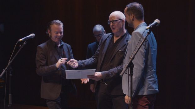"Eamonn Dowd signs his new lp onstage in the Cité du Vin, with Eamon Carr, John Fleming and Benjamin Menouret: ""The most wretched ever seen"". Photograph: Killian Ginnity"
