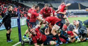 Munster celebrate James Cronin's try to secure a bonus-point win over Ospreys at the Liberty stadium in Swansea. Photograph: Gary Carr/Inpho
