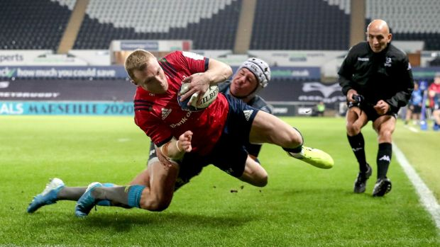 Munster's Keith Earls scores a try in the corner in the Heineken Champions Cup match against the Ospreys at the Liberty Stadium in Swansea. Photograph: Dan Sheridan/Inpho