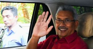 Sri Lanka's president-elect Gotabaya Rajaaksa waves from inside his car as he leaves his house to go to the election commission office in Colombo  Sunday. Photograph: Lakruwan Qanniarachchi/ /AFP via Getty Images