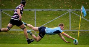 UCD's Jack Ringrose scores  one of his hat-trick of tries  in the  Energia All-Ireland League Division 1A game against Terenure at the  Belfield  Bowl. Photograph: Oisín Keniry/Inpho
