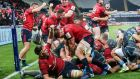 Munster celebrate as replacement prop James Cronin goes over for a try to secure the bonus point against Ospreys at the Liberty Stadium. Photograph: Gary Carr/Inpho