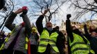 Defiant yellow-vest protesters gather in central Paris to mark the one-year anniversary of the movement. Photograph: EPA