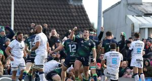 Connacht prop Denis Buckley, centre,   and his  team-mates celebrate a  late first-half try during the victory over Montpellier at the Sportsground. Photograph: Paul Faith/AFP/Getty