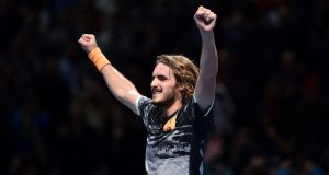 Greece's Stefanos Tsitsipas celebrates after defeating Austria's Dominic Thiem to win  the ATP World Tour Finals  at the O2 Arena in London. Photograph: Glyn Kirk/AFP via Getty Images.