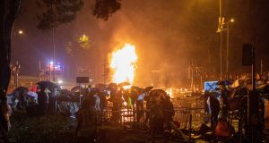A petrol bomb thrown by a protester explodes near the Polytechnic University of Hong Kong. Photograph: Jerome Favre/EPA