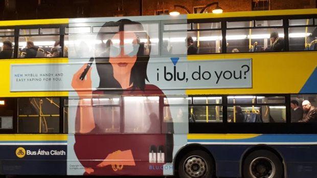 Blu, an e-cigarette brand, with a bus advertisement on Tara Street, Dublin