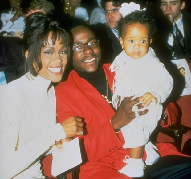 Whitney Houston with Bobby Brown and their daughter, Bobbi Kristina, in 1994. Photograph: Getty