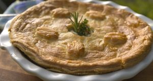 Chicken pie topped with puff pastry