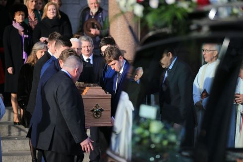 FINAL CURTAIN: A casket carrying the remains of late actor and comic Niall Tóibín is carried from the Church of St Paul of the Cross, Mount Argus, Dublin, at his funeral. Photograph: Nick Bradshaw
