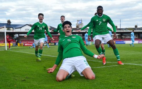 KNEES-UP TIME: Anselmo Garcia McNulty celebrates with his Republic of Ireland teammates after scoring his side's second goal during the Uefa Under-17 European Championship Qualifier match against Israel at Turner's Cross in Cork. Photograph: Piaras Ó Mídheach/Sportsfile