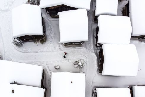 SWISS WHITE-OUT: A drone shot shows chalets covered with fresh snow in Bellwald, Switzerland. Photograph: Jean-Christophe Bott/EPA