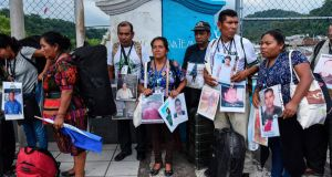Members of the XV Caravan of Central American Mothers looking for missing migrant children in Talisman, Chiapas state, on the Mexican border with Guatemala. Photograph: Getty Images