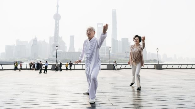 A Chinese couple doing Tai Chi on The Bund in Shanghai. Photograph: iStock