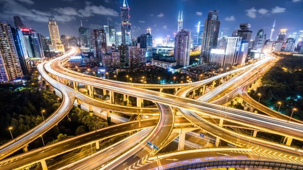 Cars passing a road intersection in downtown Shanghai. Photograph: iStock