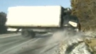 Dashcam captures flipped truck narrowly missing US police