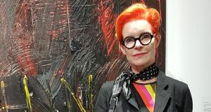Costume designer Sandy Powell in front of a Derek Jarman painting at IMMA. Photo Deirdre McQuillan