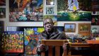 Artist and writer Joe Odiboh, who is  originally from Nigeria, at his home in Dundalk, Co Louth. He  has lived in direct provision for eight  years, but is now facing deportation. Photograph: Dara Mac Dónaill