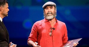 Eric Cantona speaks on stage after receiving the Uefa 2019 president's award in Monaco. Photograph: Getty Images