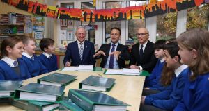 Minister for Communications Richard Bruton, Taoiseach Leo Varadkar and US businessman David McCourt signing the National Broadband plan at St Kevin's National School in Co Wicklow. Photograph: Niall Carson/PA Wire