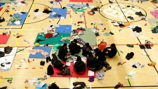 Anti-government protesters rest in the gymnasium at the besieged Hong Kong Polytechnic University. Photograph: Reuters