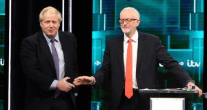 A handout photo made available by ITV shows British prime minister and Conservative party leader Boris Johnson (L) and Labour party leader Jeremy Corbyn (R) shake hands during the ITV live debate. Photograph: Jonathan Hordle/EPA