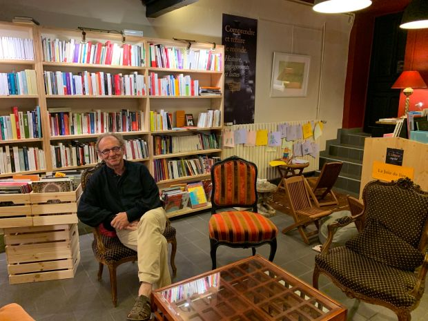 Jean-François Manier, publisher and poet, in his bookshop at L'Arbre vagabond, Le Chambon-sur-Lignon