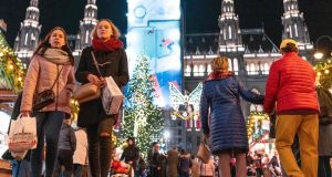 Visitors explore a Christmas market in  Vienna: Corporate travel platform Tripactions is limbering up for a major assault on the European market. Photograph:  Joe Klamar/AFP via Getty Images