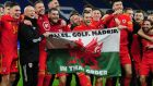 Gareth Bale and his Wales teammate celebrate with the flag after their win over Hungary in Cardiff. Photograph: Athena Pictures/Getty Images